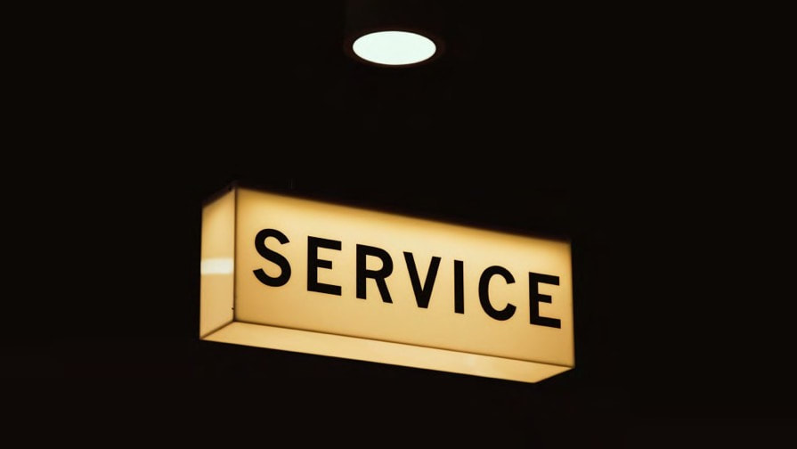 Illuminated Service sign on a black background